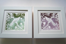 Bird in Spring papercuts in box frames.