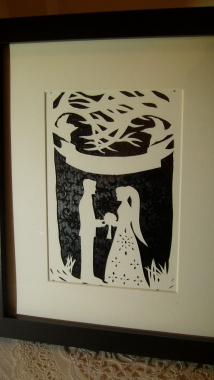 Framed wedding papercut with black background