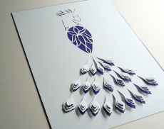 Peacock A4 papercut with royal blue background paper