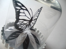 Buttefly and flower papercut in bell jar