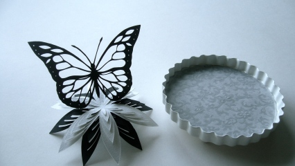 Butterfly and flower papercut with bell jar base