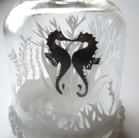 Seahorses in bell jar close up